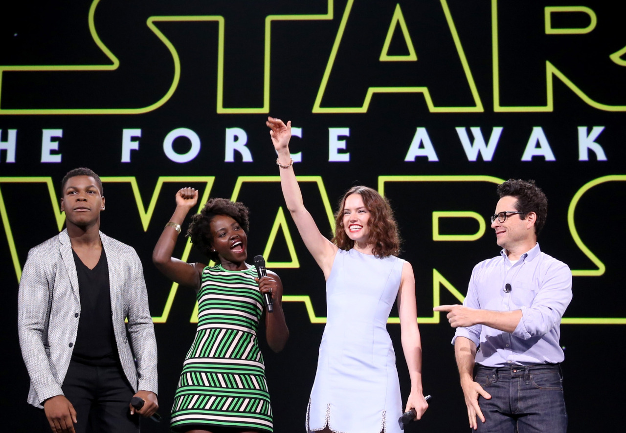 "ANAHEIM, CA - AUGUST 15: (L-R) Actors Oscar Isaac, John Boyega, Lupita Nyong'o, Daisy Ridley, director J.J. Abrams of STAR WARS: THE FORCE AWAKENS and Chairman of the Walt Disney Studios Alan Horn took part today in ""Worlds, Galaxies, and Universes: Live Action at The Walt Disney Studios"" presentation at Disney's D23 EXPO 2015 in Anaheim, Calif. (Photo by Jesse Grant/Getty Images for Disney)"