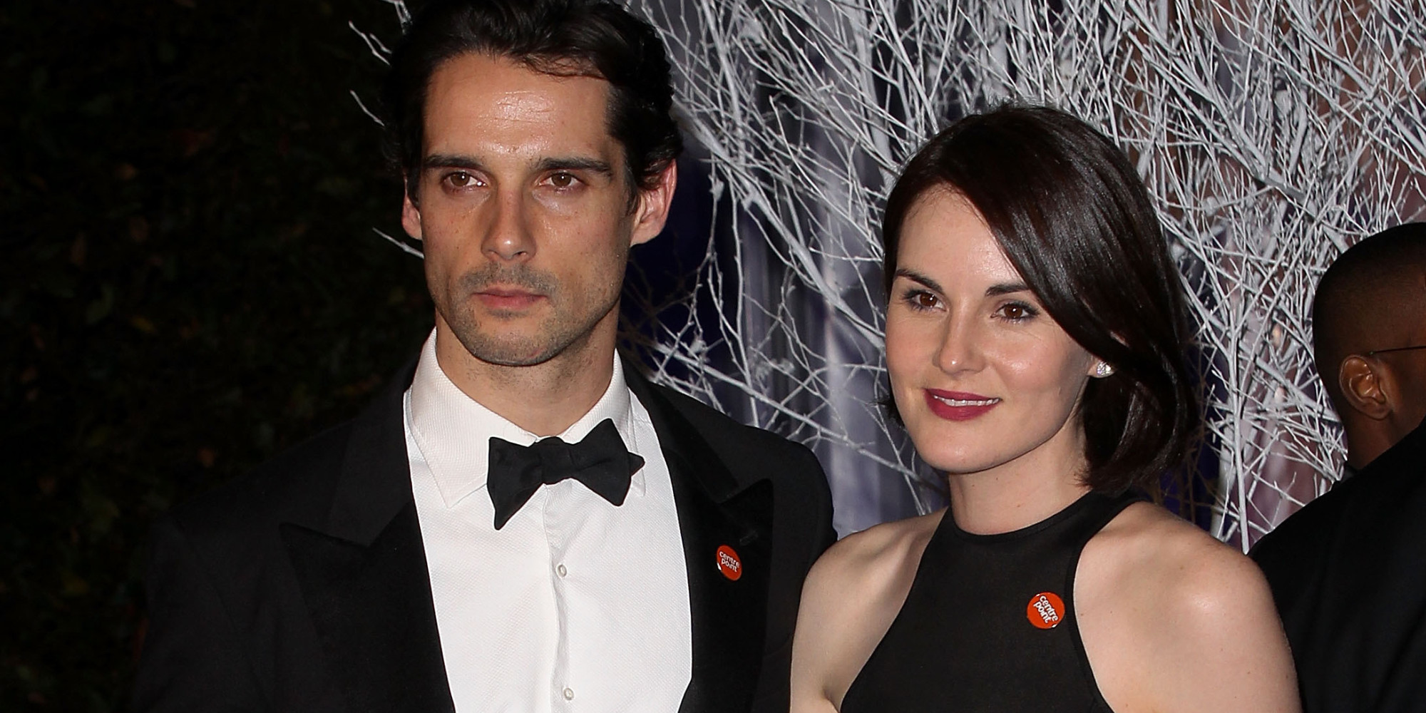 LONDON, ENGLAND - NOVEMBER 26: Michelle Dockery (R) and boyfriend John Dineen attend the Winter Whites Gala in aid of Centrepoint at Kensington Palace on November 26, 2013 in London, England. (Photo by Danny Martindale/WireImage)