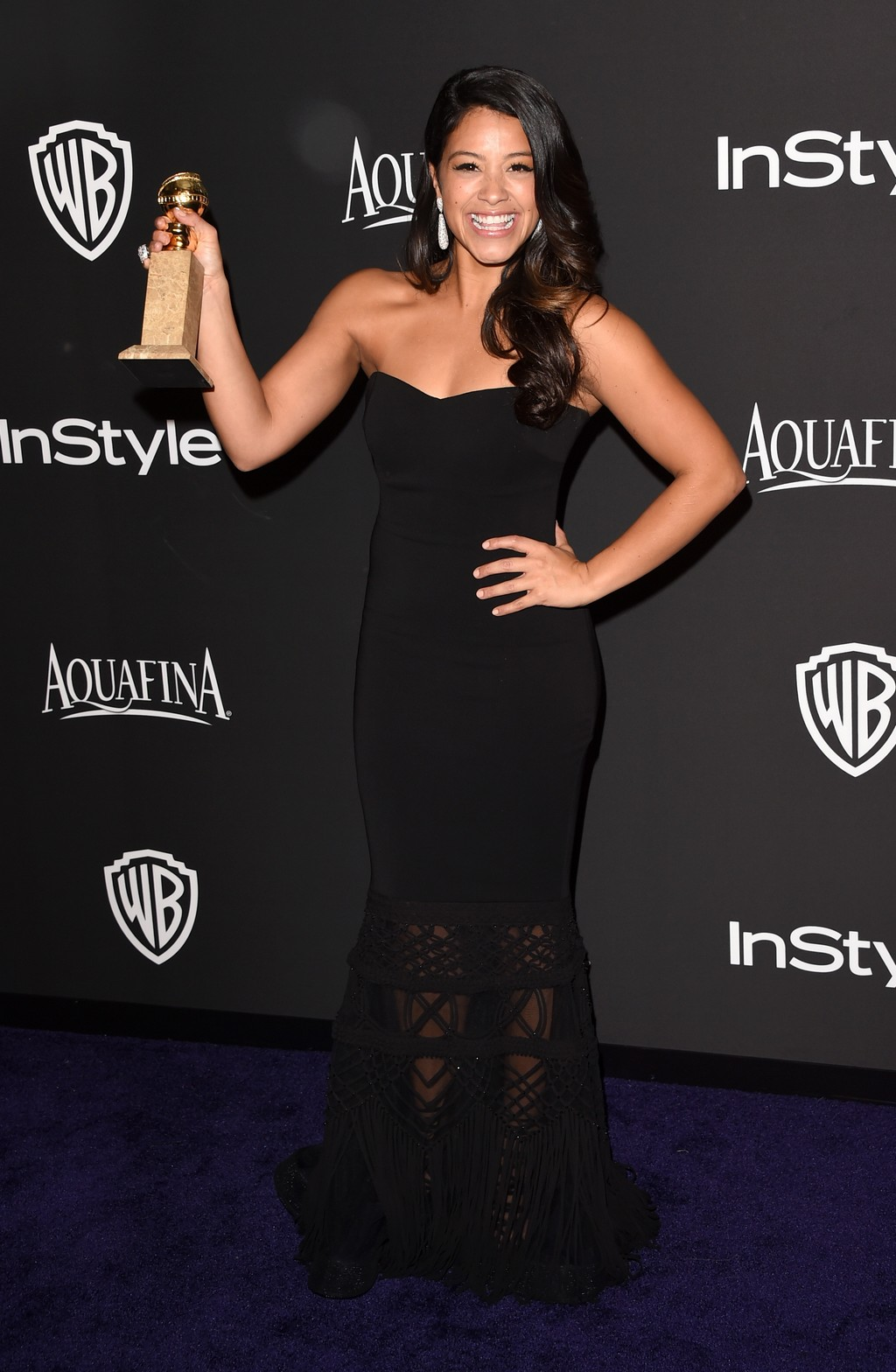 BEVERLY HILLS, CA - JANUARY 11: Actress Gina Rodriguez attends the 2015 InStyle And Warner Bros. 72nd Annual Golden Globe Awards Post-Party at The Beverly Hilton Hotel on January 11, 2015 in Beverly Hills, California. (Photo by Jason Merritt/Getty Images)
