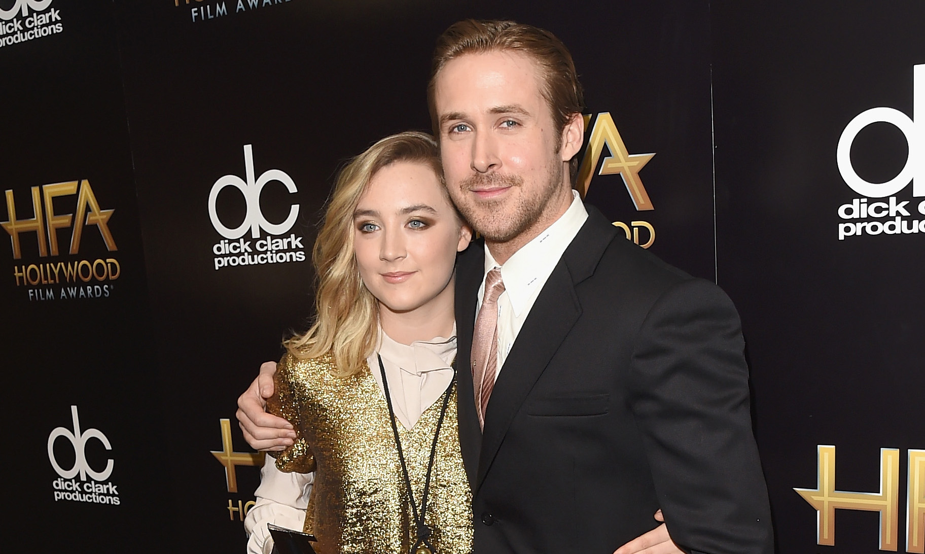 BEVERLY HILLS, CA - NOVEMBER 01: Actors Saoirse Ronan (L), winner of the New Hollywood Award for 'Brooklyn', and Ryan Gosling pose in the press room during the 19th Annual Hollywood Film Awards at The Beverly Hilton Hotel on November 1, 2015 in Beverly Hills, California. (Photo by Jason Merritt/Getty Images)