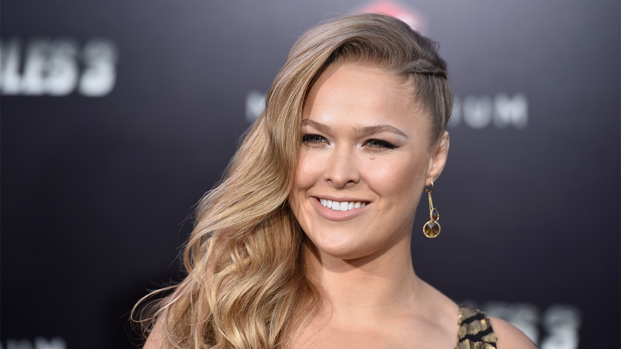 "HOLLYWOOD, CA - AUGUST 11: Actress Ronda Rousey attends Lionsgate Films' ""The Expendables 3"" premiere at TCL Chinese Theatre on August 11, 2014 in Hollywood, California. (Photo by Frazer Harrison/Getty Images)"