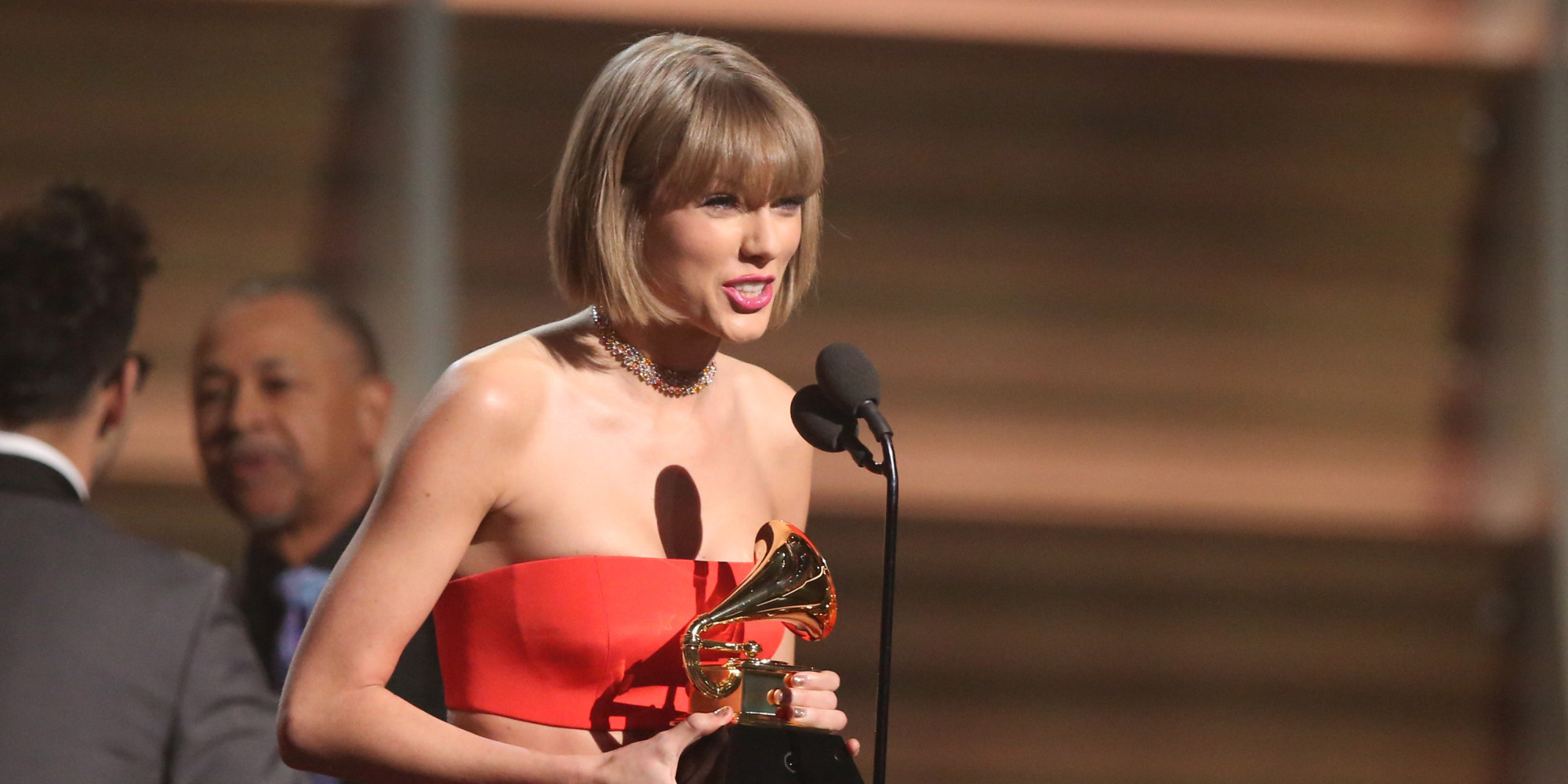 "Taylor Swift accepts the award for album of the year for ""1989"" at the 58th annual Grammy Awards on Monday, Feb. 15, 2016, in Los Angeles. (Photo by Matt Sayles/Invision/AP)"